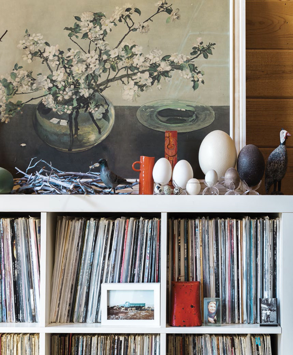 The couple decorated the house in an eclectic style, using vintage furnishings, colorful textiles, found objects and art made by friends and family.