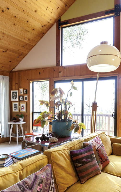 Built in 1979, the cabin was dark and choppy, so they took down walls to create a large living space with a 22-foot ceiling and a wall of windows that bring the sunlight streaming in.