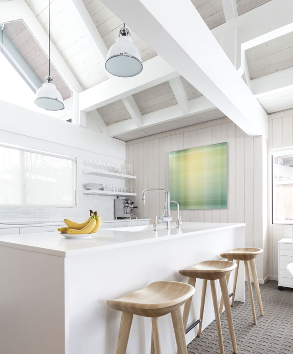 Winter White. Tractor counter stools by Craig Bassam for BassamFellows provide seating at the kitchen island.
