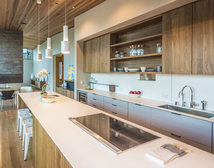 The streamlined kitchen was designed to make cooking and cleanup a cinch, even when the house is filled with guests.
